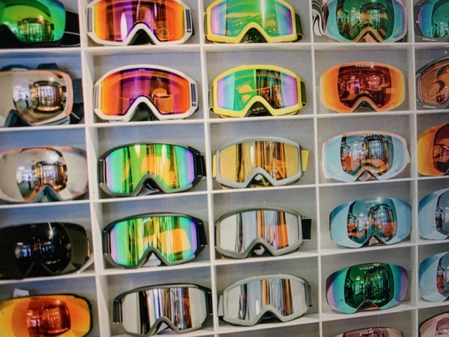 Rack of snowsport goggles